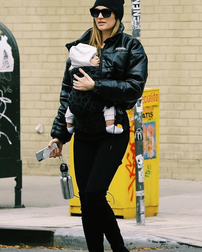 Candice Swanepoel wearing Artipoppe Zeitgeist Baby Carrier Leopard Grey