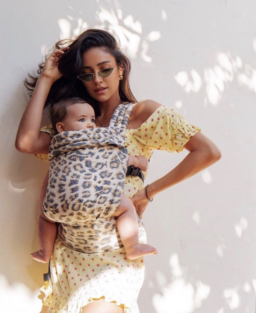 Shay Mitchell wearing Artipoppe Zeitgeist Baby Carrier Leopard Fusion