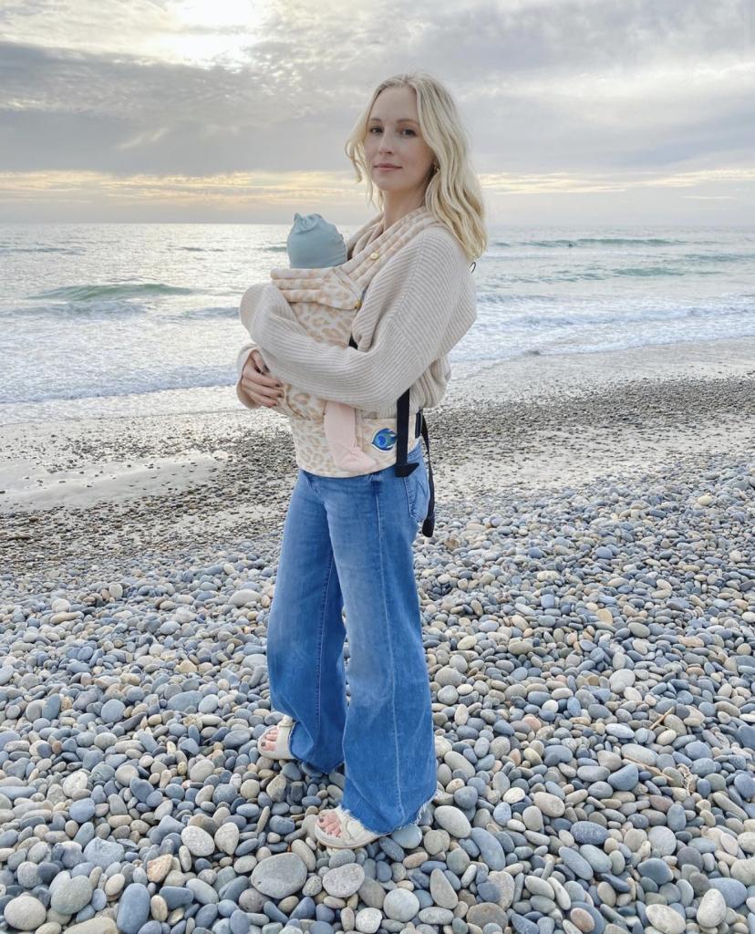 Candice King wearing Artipoppe Zeitgeist Baby Carrier Leopard Gold