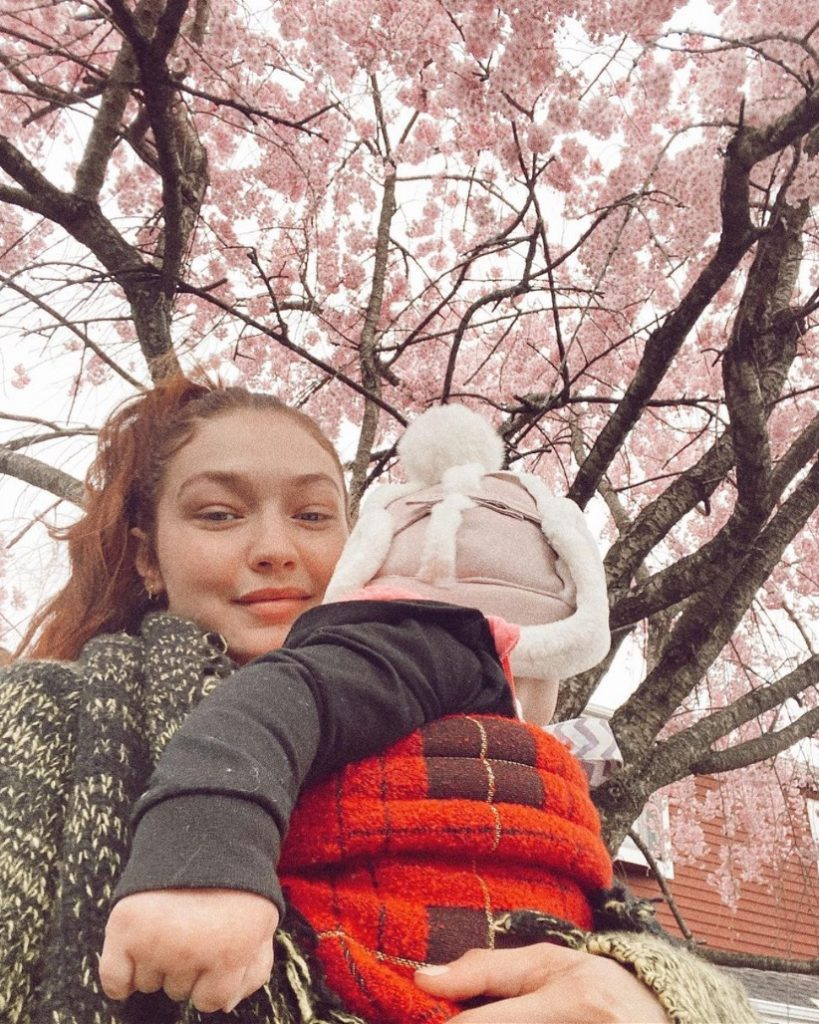 Gigi Hadid wearing Artipoppe Zeitgeist Baby Carrier Tartan